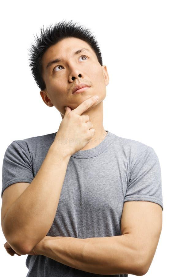 детеныши азиатского человека думая стоковые фото