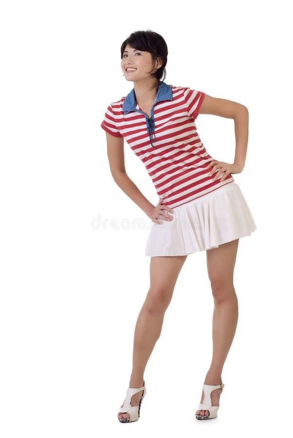 детеныши азиатской девушки счастливые стоковая фотография rf