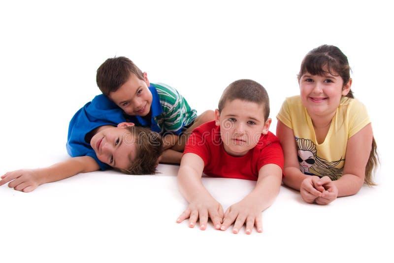 детеныши детей счастливые стоковое фото