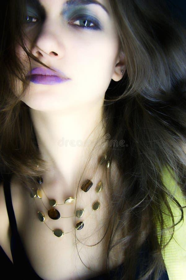 детеныши женщины волос летания стоковые изображения