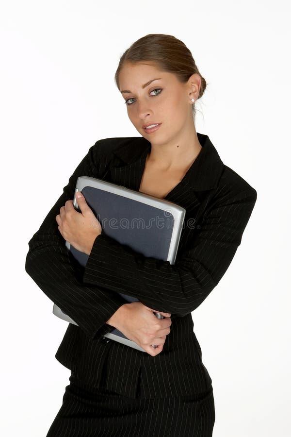 детеныши женщины компьтер-книжки удерживания дела стоковые изображения rf