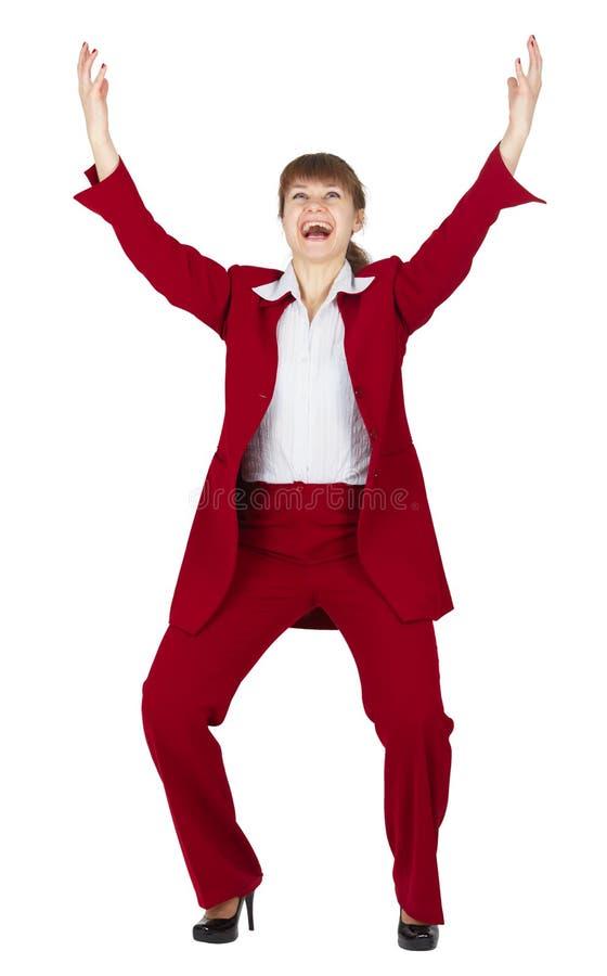 детеныши женщины костюма дела торжествующие красные стоковые изображения rf