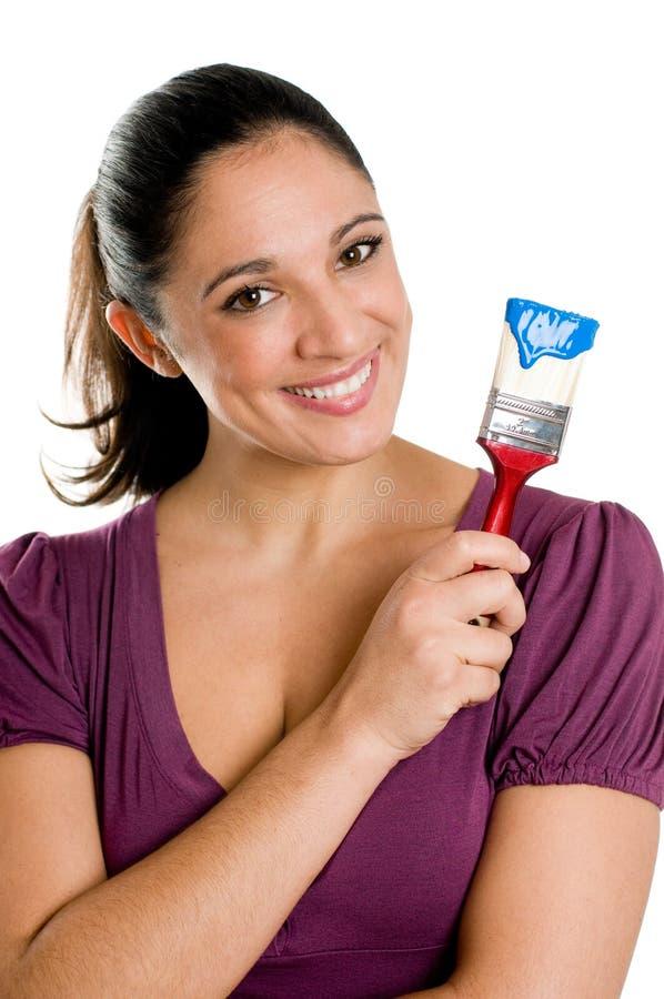 детеныши женщины краски щетки готовые стоковые фотографии rf