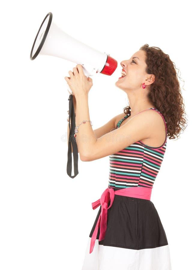 детеныши женщины мегафона крича стоковое фото rf