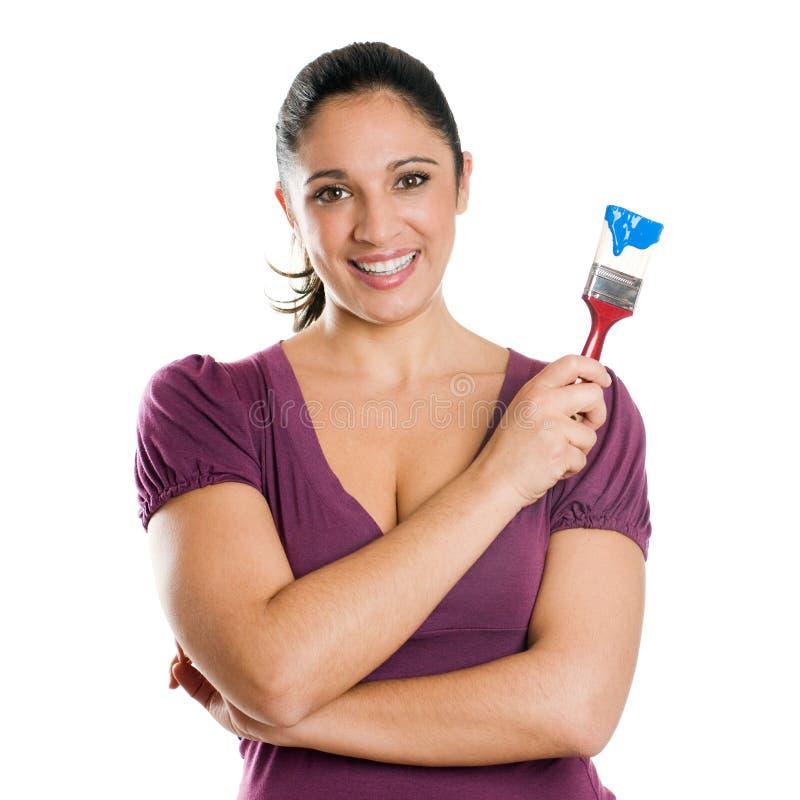 детеныши женщины радостной краски щетки готовые стоковая фотография rf