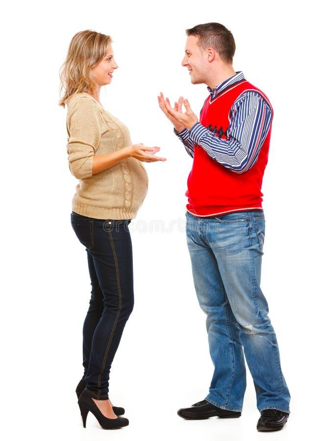детеныши женщины супруга супоросые говоря стоковая фотография