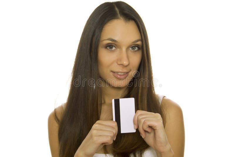 детеныши женщины удерживания кредита карточки стоковое фото
