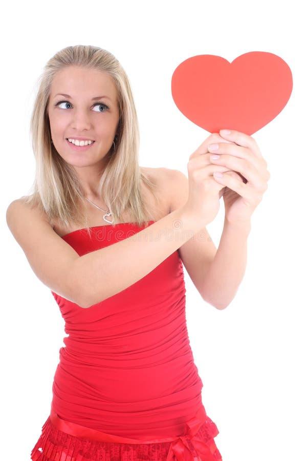 детеныши женщины удерживания сердца карточки стоковое изображение