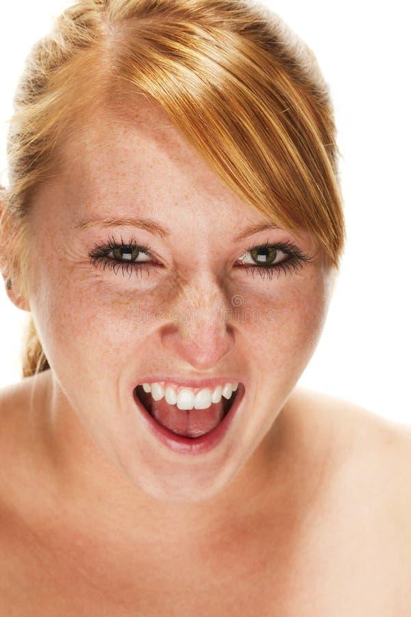 детеныши женщины redhead кричащие стоковое фото