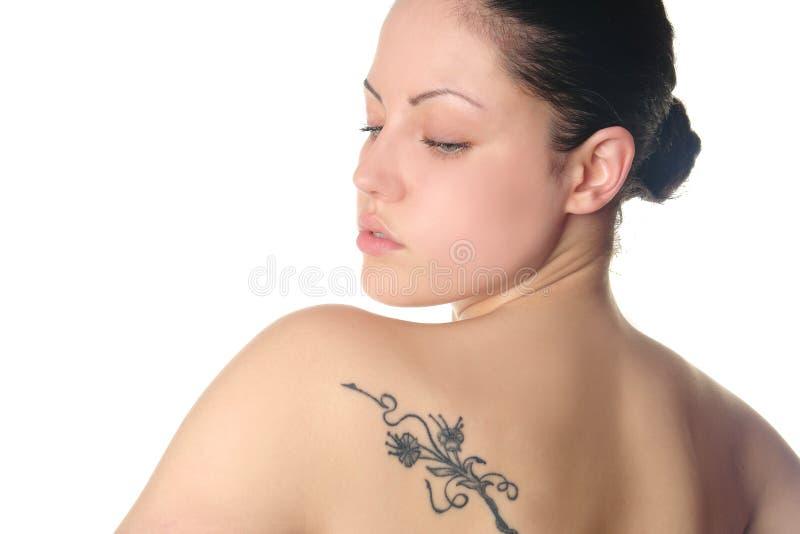 детеныши женщины tattoo стоковое изображение