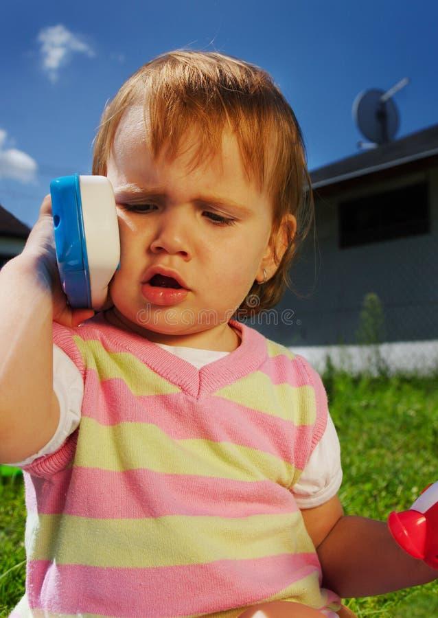 детеныши игрушки телефона ребенка стоковые изображения