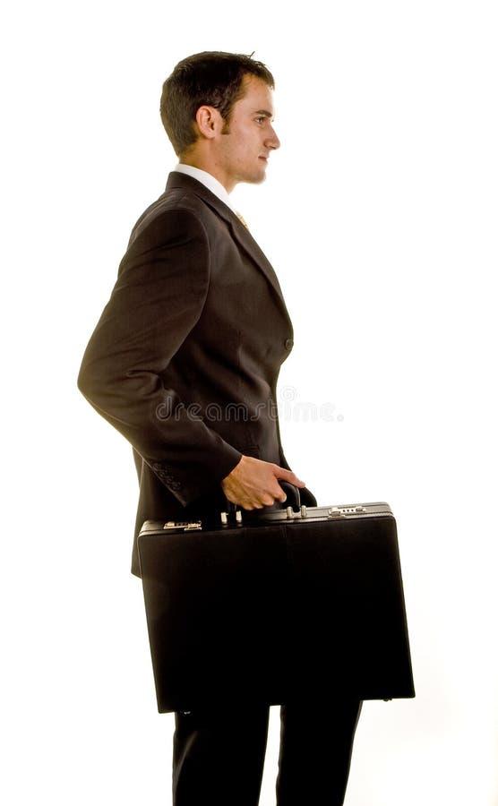 детеныши костюма стороны человека портфеля стоковое фото