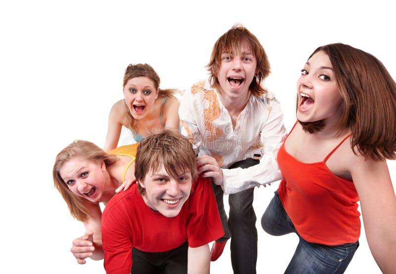 детеныши людей группы счастливые стоковая фотография rf