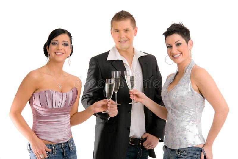 детеныши людей шампанского выпивая стоковые фотографии rf