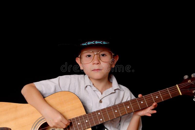 детеныши музыканта ковбоя стоковые фотографии rf