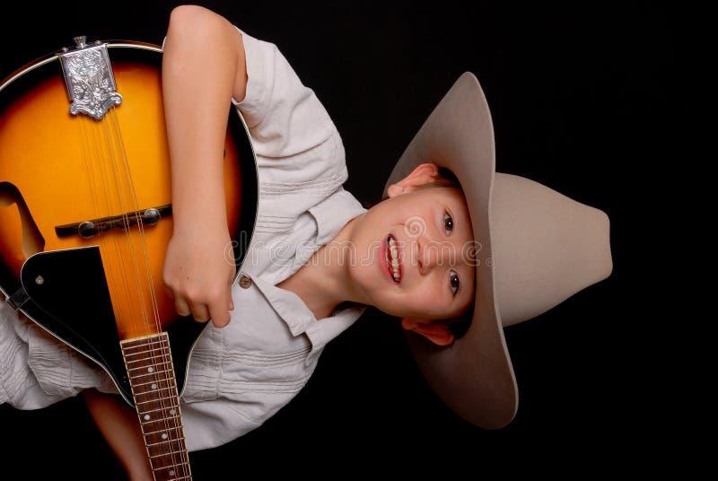 детеныши музыканта ковбоя стоковое изображение