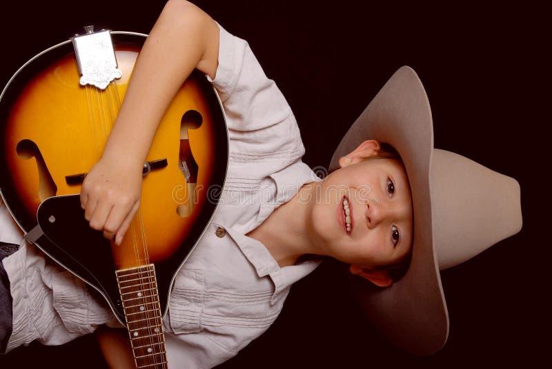 детеныши музыканта ковбоя стоковое фото rf