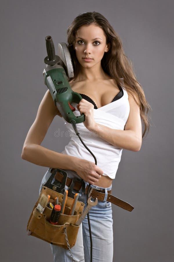 детеныши работника женщины конструкции сексуальные стоковое фото