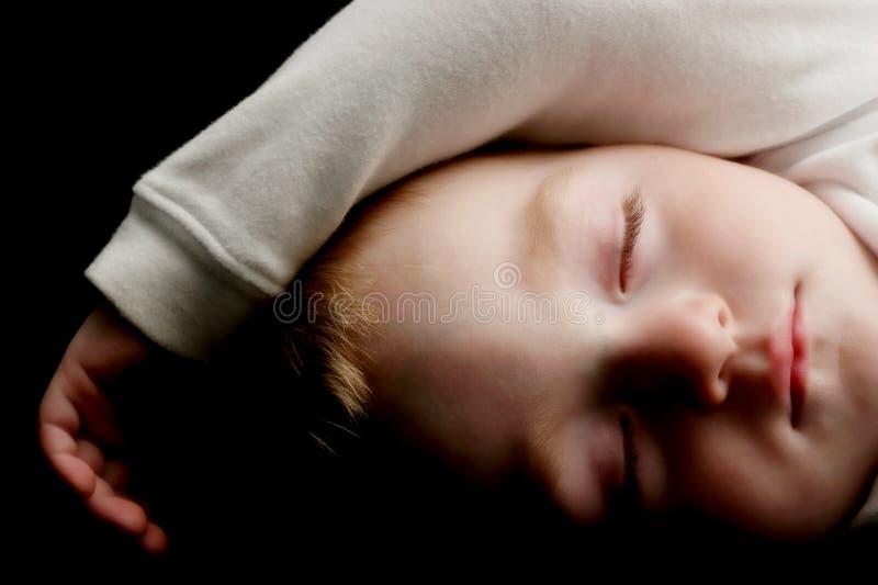 детеныши спать ребенка стоковая фотография rf