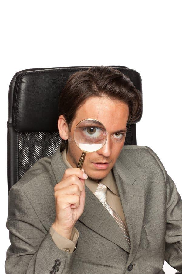 детеныши стекла бизнесмена увеличивая стоковые фото