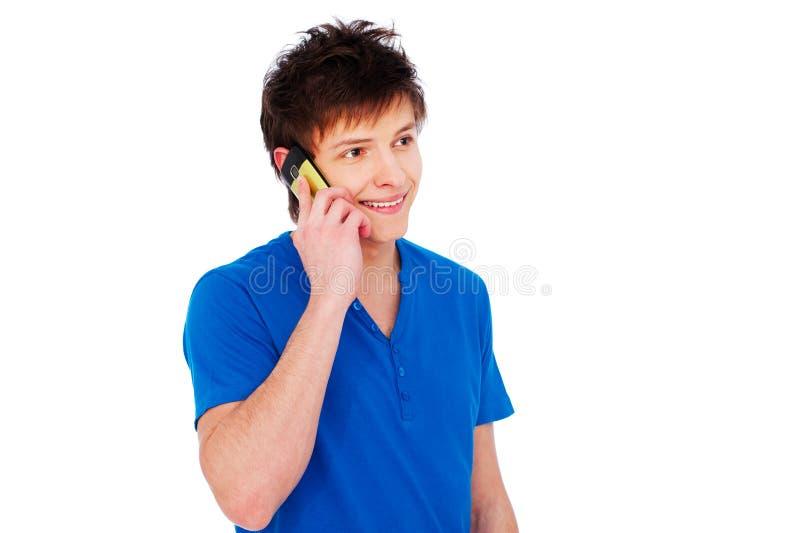 детеныши счастливого человека мобильного телефона говоря стоковая фотография rf