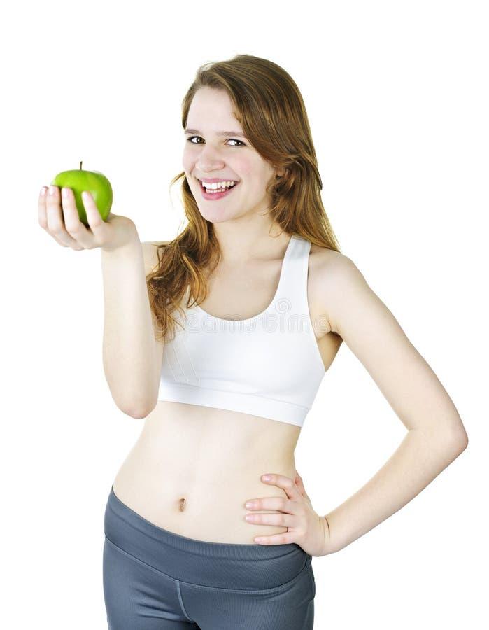 детеныши удерживания девушки яблока ся стоковое фото rf