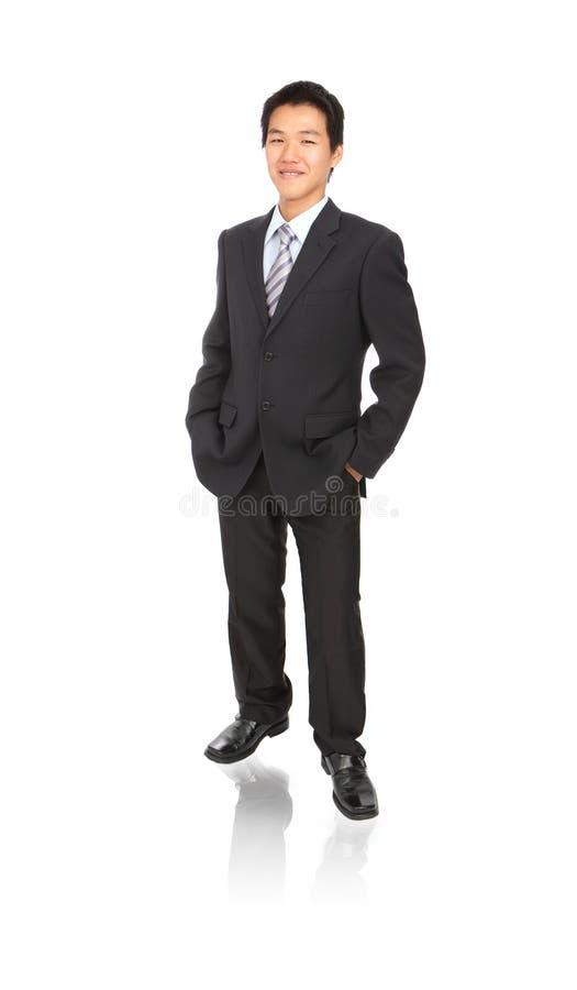 детеныши усмешки человека дела уверенно стоковое фото rf