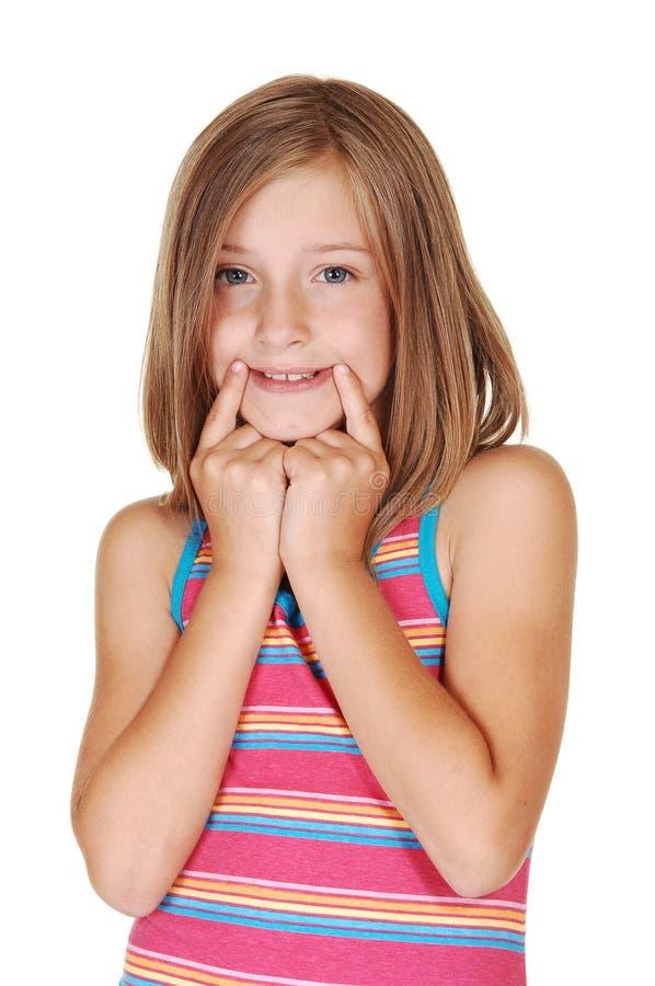 детеныши усмешки mimic девушки стоковая фотография rf