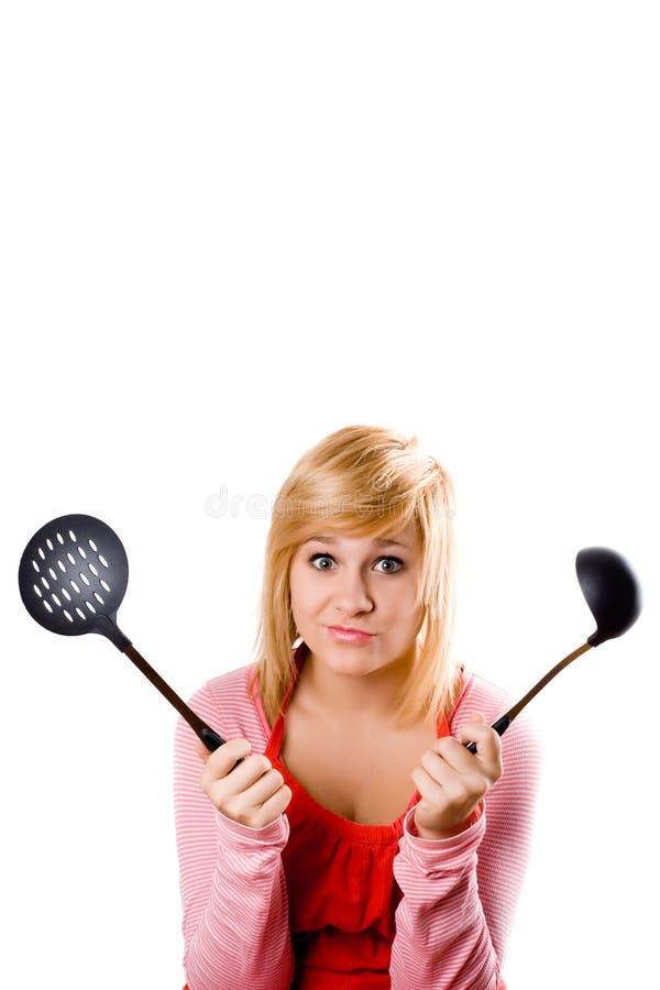детеныши утвари кухни домохозяйки стоковое фото
