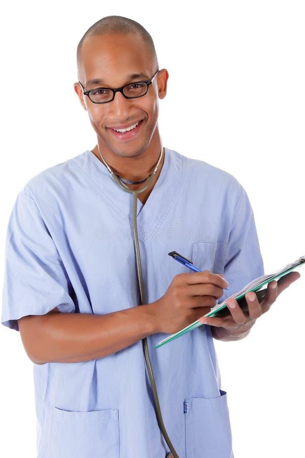 детеныши человека доктора афроамериканца успешные стоковое изображение rf