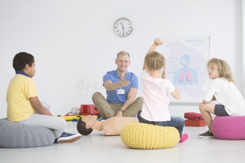 Дети во время урока стоковое изображение