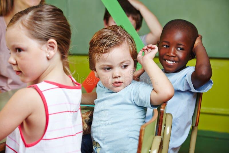 Дети в группе preschool стоковые фотографии rf