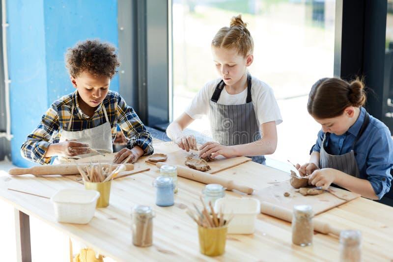 Дети делая агашко стоковая фотография