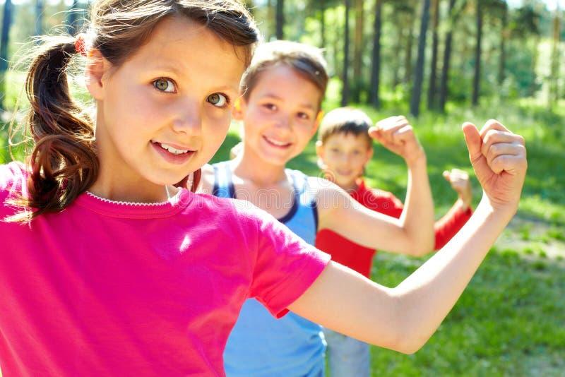 дети сильные стоковое изображение rf