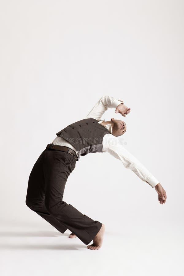 Джаз танцев человека над белой предпосылкой стоковая фотография