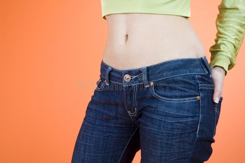 джинсыы девушки стоковые изображения