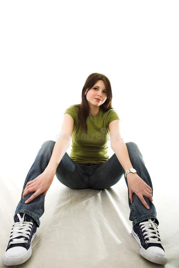 джинсыы девушки стоковое изображение