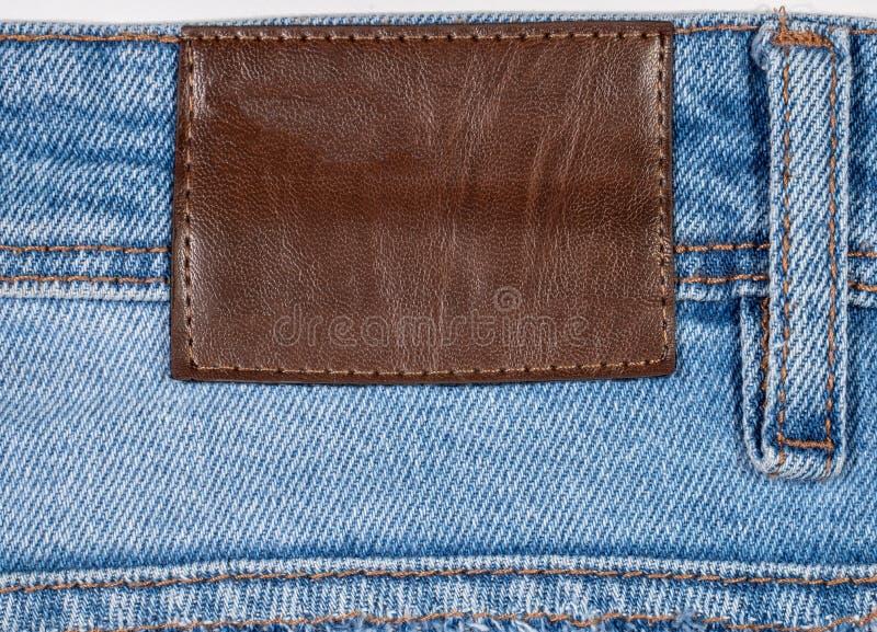 Джинсы джинсовой ткани текстурируют и детализируют стоковое изображение
