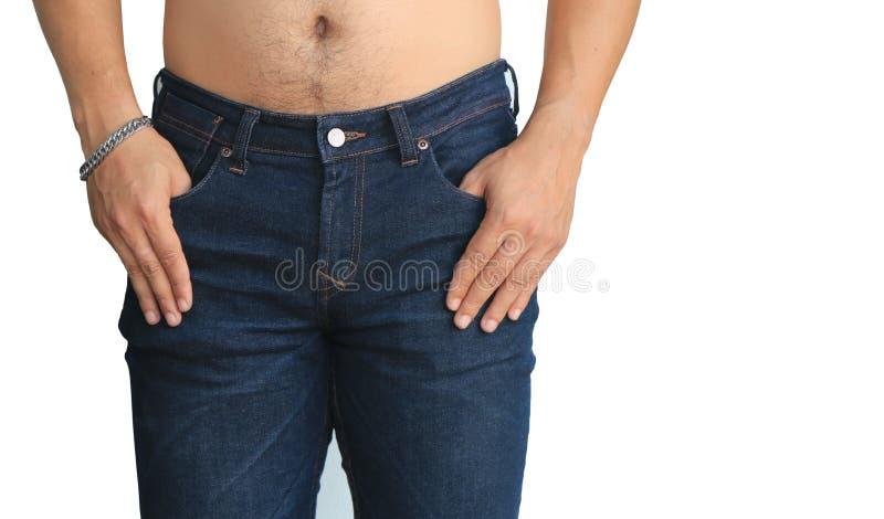 Джинсы молодого человека нося стоковая фотография rf