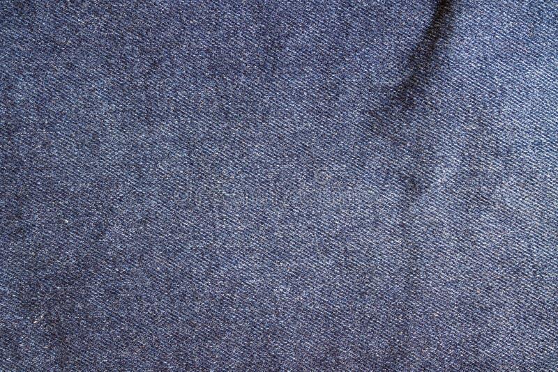 Джинсы текстурируют, ткань стоковые фото