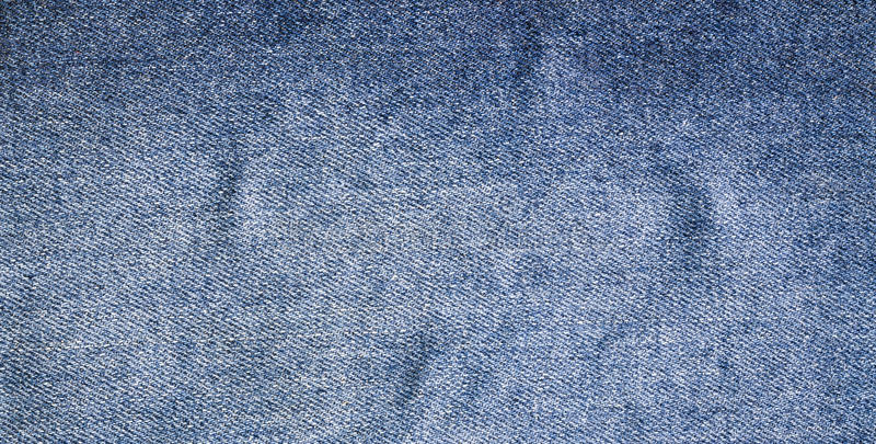 Джинсы текстурируют, ткань стоковое фото