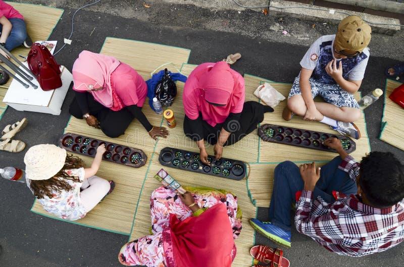 ДЖОРДЖТАУН,  8-ое июля 2016 ¼ ï PENANG/MALAYSIA: Дети имеют pla потехи стоковое фото