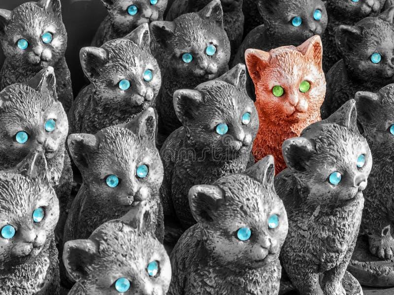 Диаграмма кот концепции с зелеными глазами отличающимися от другие в группе стоковое изображение