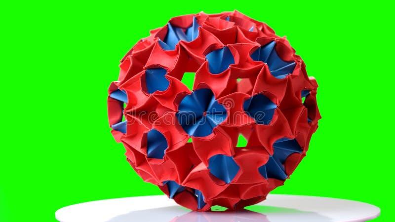 Диаграмма Origami на зеленой предпосылке стоковое изображение