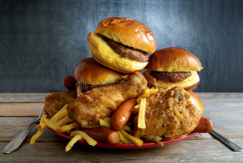 Диета высококалорийной вредной пищи стоковые изображения rf
