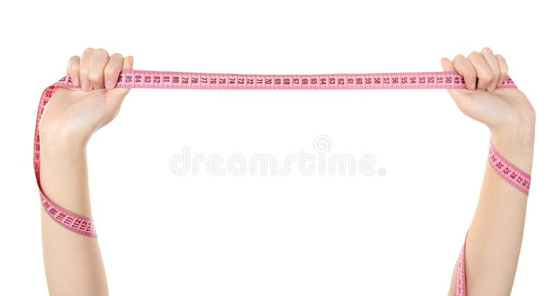 диетпитание принципиальной схемы Измеряя лента в женских изолированных руках стоковое изображение rf
