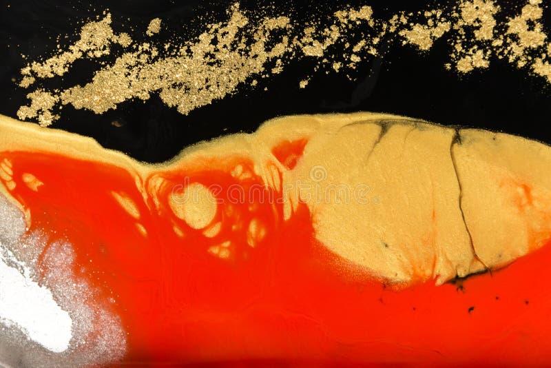 Дизайн текстуры золота мраморизуя Красная и золотая мраморная картина Жидкое искусство стоковая фотография