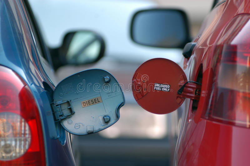 Дизель против бензина стоковое фото rf
