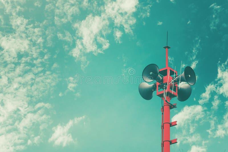 Диктор рожка для связей с общественностью подписывает символ, винтажный цвет стоковая фотография rf