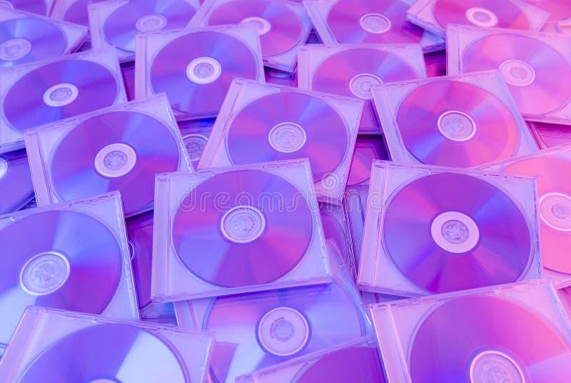 диски предпосылки цветастые компактные стоковая фотография